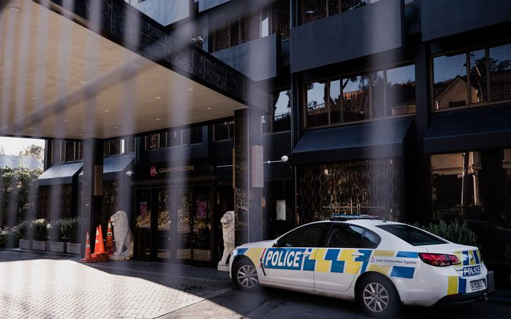 Police at the Grand Mecure Hotel in Wellington, which is being used as a managed isolation facility.