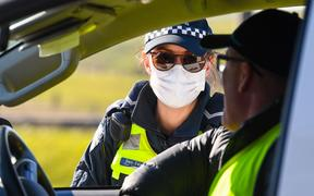 Police conduct roadside checks on the outskirts of Melbourne on July  9, 2020 on the first day of the city's new lockdown after an outbreak of the COVID-19 coronavirus.