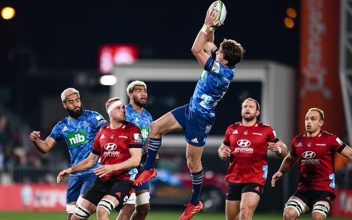 Beauden Barrett of the Blues takes a high ball during the Super Rugby Aotearoa, Crusaders V Blues, at Orangetheory Stadium, Christchurch, New Zealand, 11th July 2020.