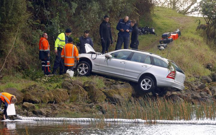 A car is winched out of Lake Rotoma after a crash that claimed two lives.