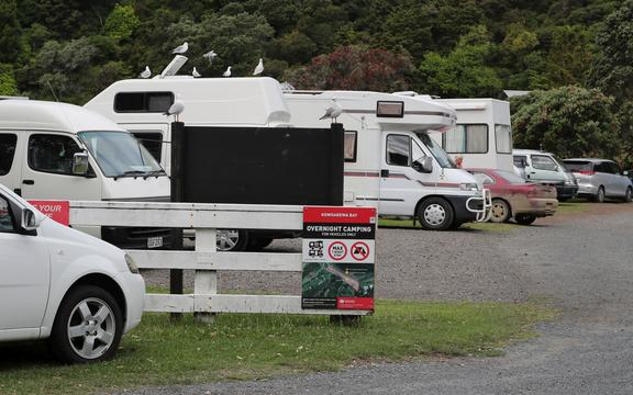Freedom campers at Kowharewa Bay, on the Tutukaka coast. 31 December 2018 Northern Advocate Photograph by John Stone