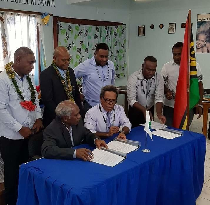 OFC President Lambert Maltok and MSG Secretariat Acting Director General George Hoa'au sign the MoU.