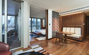 The new Park Hyatt Hotel has 195 rooms which have been designed to reflect a Māori wharenui (house).