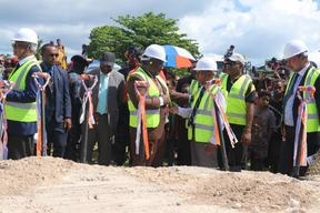 Papua New Guinea's Prime Minister James Marape (centre, brown suit) talks to New Ireland provincial Governor Sir Julius Chan at a groundbreaking ceremony for the upgrade of Kavieng airport, 16 July 2020.