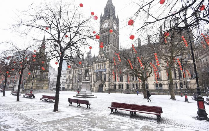 A snow covered Albert Square and Manchester Town Hall in Manchester city centre in the UK as Britain faces a wave of cold weather, nicknamed the 'beast from the east' in the British press as well as storm Emma - March 1, 2018.