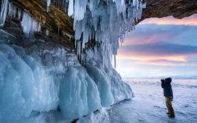 In this unlocated photo, a wonderful winter view around Lake Baikal, the largest freshwater lake by volume in the world, where pure ice and white snow are seen, southern Siberia, Russia.