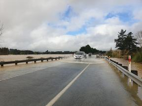 A car drives through flooding in Northland on 18 July.