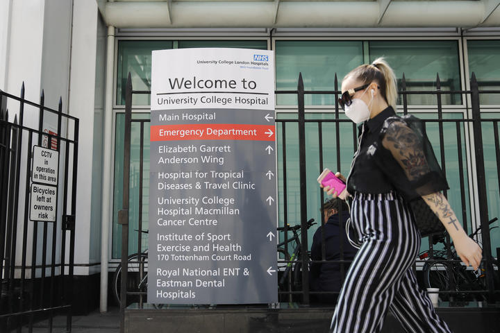 A pedestrian outside University College Hospital in London, where the coronavirus is being researched.