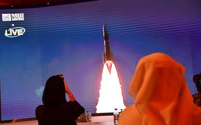 A picture taken on July 19, 2020, shows a screen broadcasting the launch of the 'Hope' Mars probe at the Mohammed Bin Rashid Space Centre in Dubai, UAE