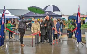 Kawerau Mayor Malcolm Campbell (centre) cuts the ribbon on the completed units alongside new owners (from left) Kath Cook, Averil Edhouse and Zita King.