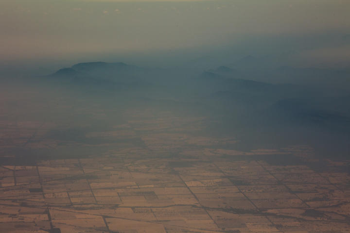 Smoke and haze over mountains seen from an Australian air force aircraft assessing damage in the area from bushfires, in Cooma in New South Wales on 7 January, 2020.