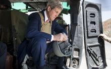 US Secretary of State John Kerry flew into Iraq for talks with its new leaders.