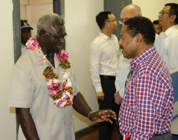 Solomon Islands Prime Minister Manasseh Sogavare (L) opened the Pacific Games Office on Wednesday.