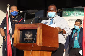 PNG's Pandemic Response Controller David Manning (left), Prime Minister James Marape (centre) and Acting Health Secretary Paison Dakulala (right).