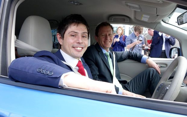 Green MP Gareth Hughes (left) and co-leader Russel Norman in a Nissan Leaf electric car at a campaign announcement on energy.