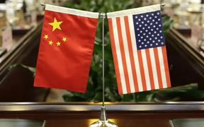 (FILES) In this file photo taken on June 30, 2017, flags of the US and China are placed ahead of a meeting at the Ministry of Agriculture in Beijing.