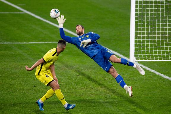 SYDNEY, AUSTRALIA - JULY 25: Wellington Phoenix goalkeeper Stefan Marinovic (1) dives to make a save during the round A-League soccer match between Wellington Phoenix and Adelaide United on July 25, 2020 at Bankwest Stadium in Sydney, Australia. (Photo by Speed Media/Icon Sportswire)