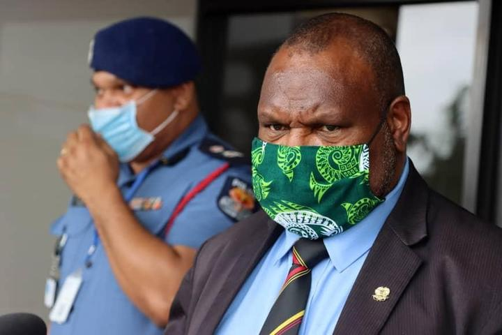 PNG's police commissioner David Manning (left) and prime minister James Marape
