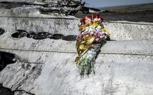 Flowers left by parents of an Australian victim of the crash, laid on a piece of the wreckage in eastern Ukraine