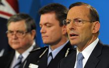 Prime Minister Tony Abbott, right, with Australian Federal Police deputy commissioner Andrew Colvin, centre, and ASIO chief David Irvine.