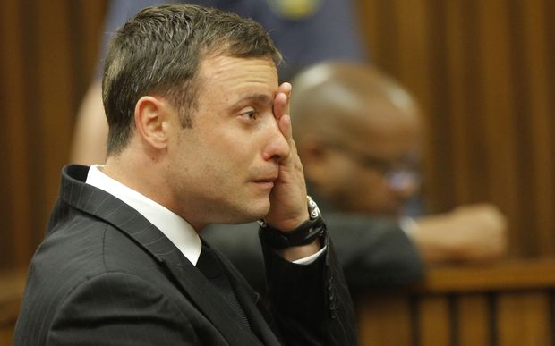 South African Paralympic athlete Oscar Pistorius cries in the dock during the verdict in his murder trial, Pretoria, South Africa, on September 11, 2014.