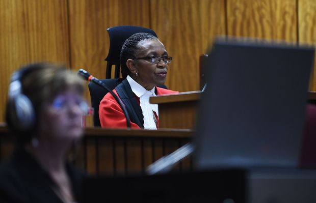 Judge Thokozile Masipa hands down her verdict on September 11, 2014 at the High Court in Pretoria on whether South African paralympian athlete Oscar Pistorius is guilty of the 2013 Valentine's Day murder of his model girlfriend.