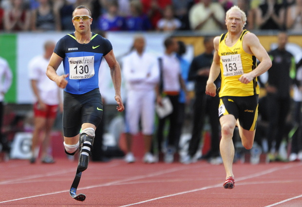 Double amputee South African Oscar Pistorius (L) competes with his carbon fibre blades next to British Thomas Iwan during his 400 metres race at the Athletics Meeting on July 16, 2008 in Lucerne.