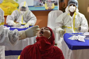 A girl gets tested for Covid-19 in Kolkata.