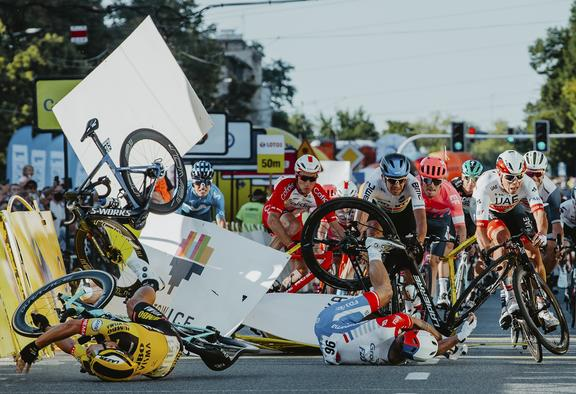Dutch cyclist Fabio Jakobsen's bicycle (behind,L) flies through the air as he collides with compatriot Dylan Groenewegen (on the ground ,L) during the opening stage of the Tour of Poland race in Katowice , southern Poland on August 5, 2020.