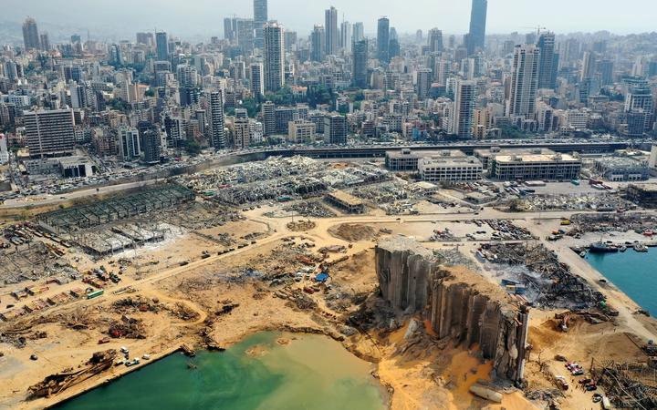 An aerial view taken on August 7, 2020, shows a partial view of the port of Beirut, the damaged grain silo and the crater caused by the colossal explosion three days earlier of a huge pile of ammonium nitrate that had languished for years in a port warehouse,