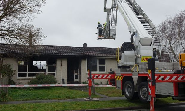 A fire service crew at the scene of the Parklands house fire in Christchurch.