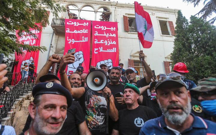Lebanese protesters gather in the courtyard of the Ministry of Foreign Affairs in Beirut on August 8, 2020, after they stormed the headquarters