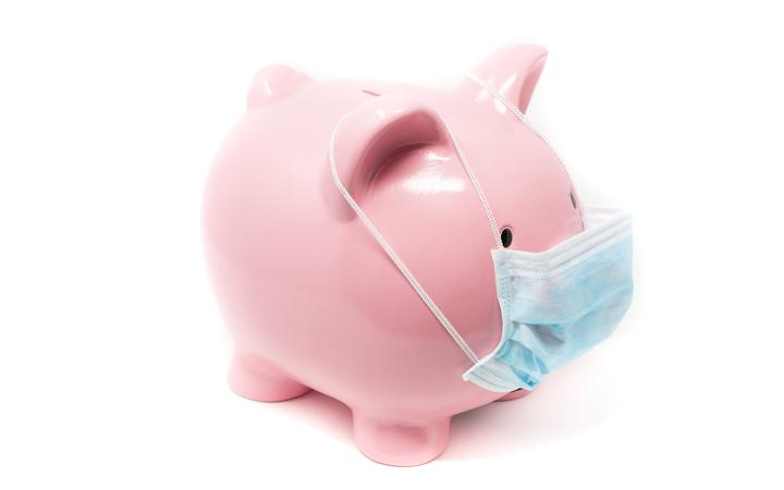 Piggybank wearing surgery mask, concept of the impact on world Economy in a pandemic