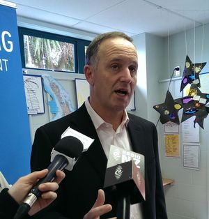 John Key talking to the media about poverty yesterday.