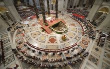 Brides and grooms during their wedding ceremony at St Peter's Basilica.