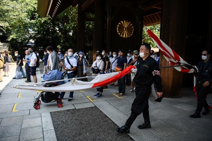 Members of a far right group parade inside the Yasukuni shrine in Tokyo on August 15.