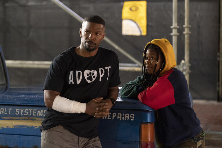 Jamie Foxx as Art (The Major) and Dominique Fishback as Robin in Project Power.