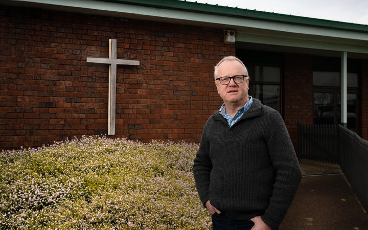 Pastor Rob Markley outside of the Birkenhead Baptist Church.