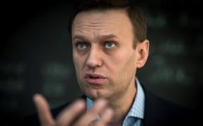 Russian opposition leader Alexei Navalny speaks during an interview.