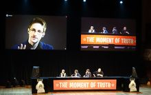 Edward Snowden talking via video link at the meeting.