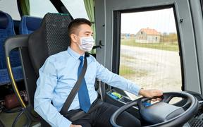 Bus driver wearing face mask - covid-19 coronavirus, public transport, face covering