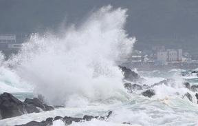High waves batter the coastline in Seogwipo on the island of Jeju on August 25, as Typhoon Bavi approaches South Korea.