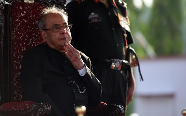 In this file photo taken on September 10, 2016 then-president Pranab Mukherjee reviews a passing out parade of cadets during their graduation ceremony at the Officers Training Academy in Chennai.