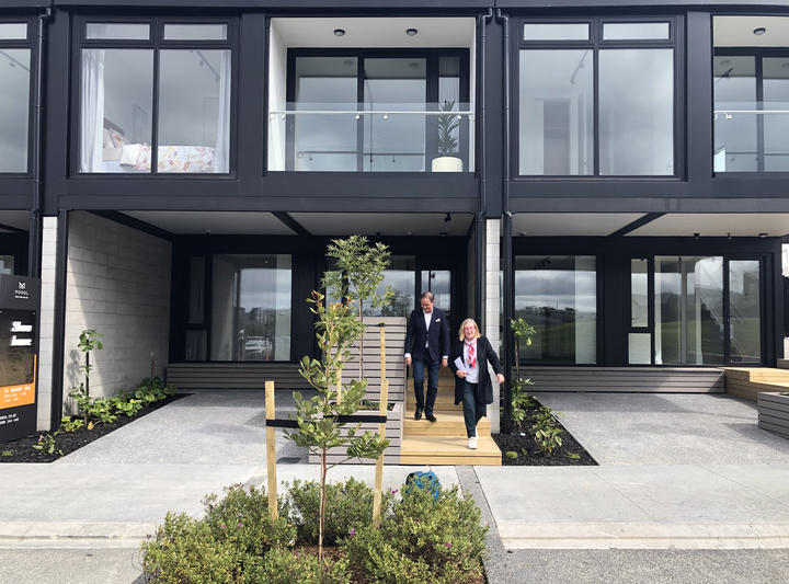 Anne Gibson and Tony Houston outside the new Hobsonville pre-fab housing