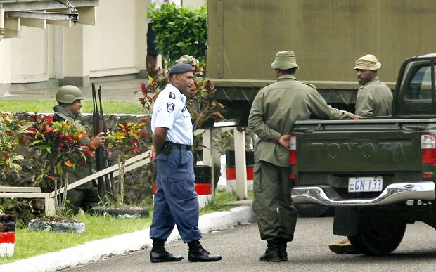 Members of Fiji police and military forces.