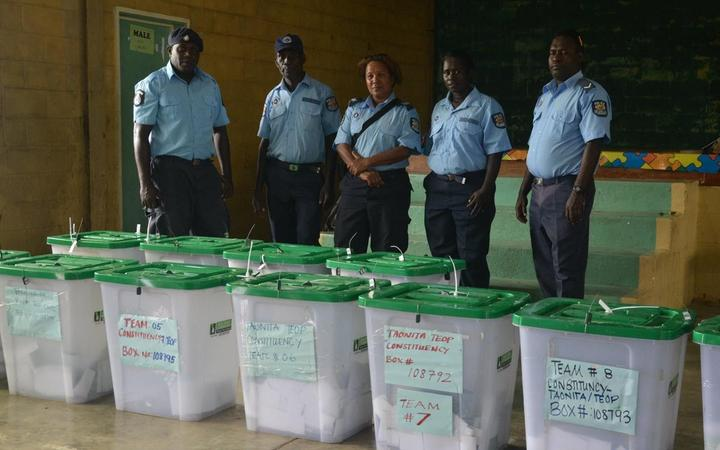 Police guard ballot boxes filled during 2018 by-elections in Bougainville.