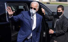 Joe Biden waves as he arrives at New Castle County Airport for his trip to Kenosha, Wisconsin, September 3, 2020 in New Castle, Delaware.  Jacob Blake, a Black man who was shot in the back 7 times by a police officer