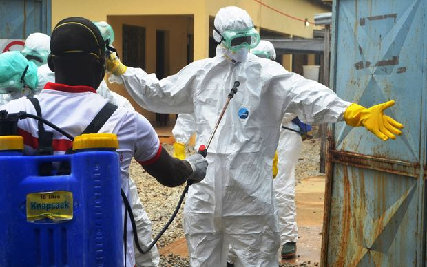 Guinea's Red Cross health workers wearing protective suits to protect them from Ebola