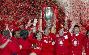 Liverpool captain Steven Gerrard lifts the trophy surrounded by celebrating team-mates after their 2005 UEFA Champions League Final victory over AC Milan.