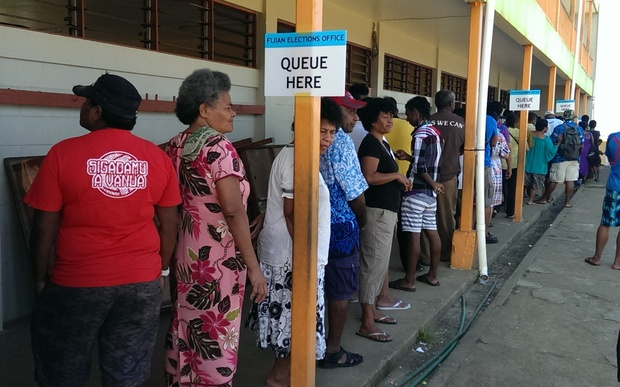 Voters queue at John Wesley College in Fiji